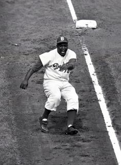 Jackie Robinson, the great disruptor, dances off of third in the 8th inning of Game 3 of the 1955 World Series.