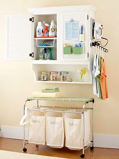 Instant Laundry Station  Combine a wall-hung cabinet with a laundry-cart-on-wheels to turn a sliver of wall space into a convenient laundry center. An inexpensive iron holder attached to the side of the cabinet keeps the iron within reach, and a space-saving clothes hanger holds ironed items temporarily.