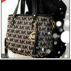 Authentic Michael Kors bag Authentic Michael kors bag only used once or twice. Its the perfect medium size bag for that lady that carries a lot of things. Wallet sole separately. Michael Kors Bags