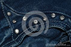 a fragment of dark blue jeans, decorated with bright rhinestones.