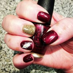 Garnet and Gold FSU nail art with feather.