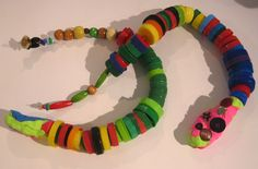 recycle bottle cap snakes with crayola model mage beads awesome project. - Art Matters Studio www.artmatterstudio.com