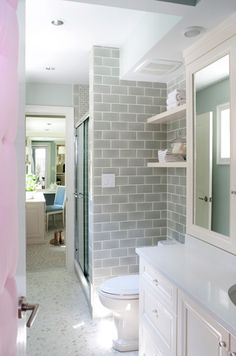 divine bathroom design with gray subway tile backsplash and beautiful white bathroom cabinets with ivory medicine cabinet and ivory floating shelves