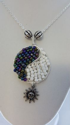 YEN YANG Beaded Pendant with Moon Charm, Beaded Pendant Yen Yang Symbol with White and Iridescent Metallic beads and Moon Symbol Charm - pinned by pin4etsy.com