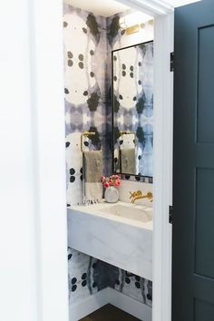 Bold wallpaper in the powder room Studio McGee Powder Room Wallpaper, Bold Wallpaper, Bathroom Wallpaper, Preto Wallpaper, Graphic Wallpaper, Wallpaper Decor, Studio Mcgee, Tiny Powder Rooms, Floating Sink