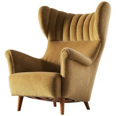 Large Italian Wingback Chair in Mohair | From a unique collection of antique and modern wingback chairs at https://www.1stdibs.com/furniture/seating/wingback-chairs/