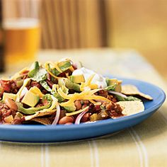 Convert carnivores into vegetarians (if only temporarily) with this recipe: The meatless crumbles are nearly indistinguishable from ground beef. Add to that the fiery heat of chipotles, creamy avocado and sour cream, and plenty of cheese, and you've got a great plate of nachos. Best of all, this version has only 408 calories per serving and provides nearly half a day's fiber and more than a third of a day's calcium.View Recipe: Vegetarian Chipotle Nachos
