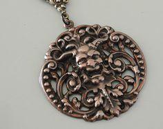 This is a gorgeous vintage brass Art Nouveau pendant. Beautiful graceful Iris flowers. Rich warm patina.    This pendant measures 1 3/4 long and 1