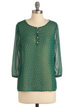 This could be a blouse for breezy summer days or layered with neutrals during the fall. Do want.