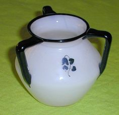Three-handled version with enameled floral motif; possibly Dagobert Peche (unconfirmed)