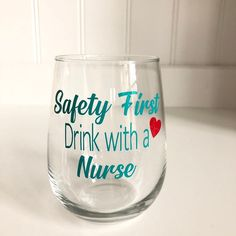 Safety First Drink with a Nurse Wine Glass / Nurse Graduation Gift / Graduation Gift / Graduation Wine Glass / Nurse Graduation Gift / Nurse Gift / 2019 He nurseNurse wine glass. Wine Glass Sayings, Wine Glass Crafts, Bottle Crafts, Sayings For Wine Glasses, Wine Quotes, Diy Wine Glasses, Mermaid Wine Glasses, Christmas Wine Glasses, Safety First