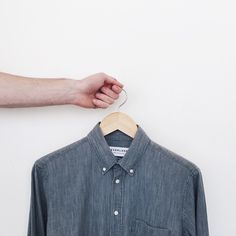 We'll be producing our tailored shirts in a new factory starting with the Grey Denim. The factory is located in Shenzhen and has been recognized for minimizing its carbon footprint. This is a move we can all feel good about. Denim Button Up, Button Up Shirts, Tailored Shirts, Minimal Chic, Fashion Photography, Shirt Dress, Carbon Footprint, Mens Tops, Shenzhen