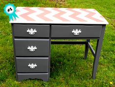 Medium gray, white and bright coral chevron desk revamped by us.