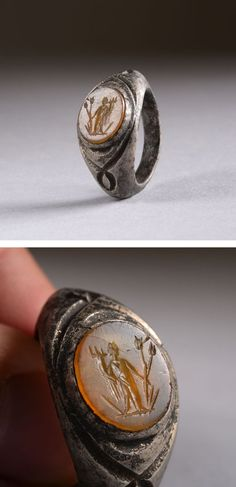 Ancient Roman silver orange intaglio ring depicting the goddess Fortuna, dating to around 150 AD.: