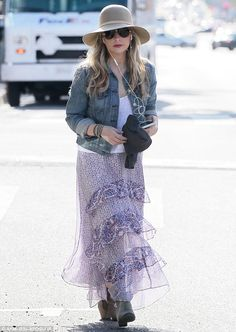 Pretty as a petal! Sarah Michelle Gellar looked lovely in a flowing, purple skirt as she s...