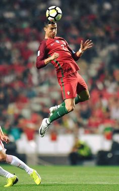 Ronaldo of Portugal flying in the air to head the soccer ball.
