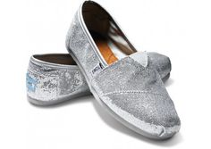"My silver sequin casual shoes have begun to wear...which means these silver glitter ""Toms"" really need to become mine."