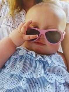 Princess Pink Babiators + Baby Gap Ruffle Swimsuit.  Too much cute!