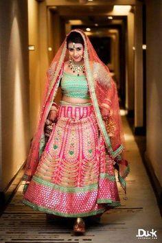 Bridal Lehengas - Mint Green and Fuschia Pink Wedding Lehenga | WedMeGood | Beautiful Bride in a Pink Lehenga with Gold Embroidery and Mint Green Blouse with Dull Orange Dupatta  #wedmegood #indianbride #indianwedding #lehenga #bridal #choli #dupatta