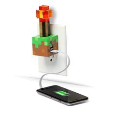 ThinkGeek's Minecraft Redstone Torch USB Wall Charger plugs into your wall socket and provides one 2.1A and one 1A USB port for your devices, and its single LED bulb also provides a dim, eerie light.