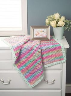 Prism Colors Blanket - Rainbow & Mint - Fascinating stripes form as you work this easy shell pattern. Kit includes Prism and Baby's Best yarns.