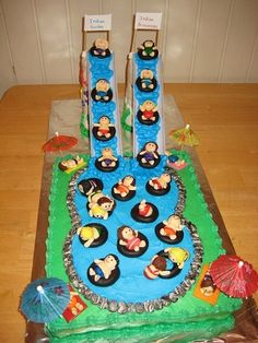 What a fantastic summer swimming-pool-slide cake - It would be great as a water park ride too!