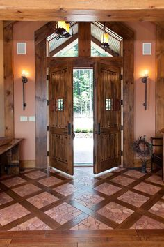 the front door, the floors, and the wall sconces