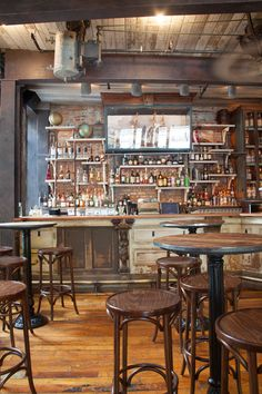 Bar - The bar area of Preserve24, industrial style, bar height cast iron table bases and stools, hard wood floors,