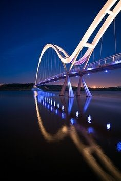 Violet Blue Dusk mirrors bridge in watery symmetry..