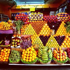 Fruit and vegetable vendors take pride in their displays, as seen in this picture. Unless you know the vendor and he/she doesn't mind, never pick up something yourself. Wait your turn and ask. Produce Displays, Fruit Displays, Fruit And Veg, Fresh Fruit, Juice Bar Design, Vegetable Shop, Fruit Shop, Fruit Stands, Beautiful Fruits