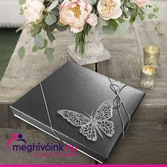 A special boxed invitation with a butterfly on the lid and a bow tied with silver twine. The text is placed on the accordion-like folded insert. Dimensions: 145 × 145 mm #eskuvoimeghivokeszites #esküvő #eskuvo #esküvőimeghívó #eskuvoimeghivo #wedding #menyasszonyvagyok #menyasszonylettem #esküvőnk #esküvő2021 #eskuvo2021 #nagynap #ferjhezmegyek #meghivo #meghívók #weddingcard #weddingcards #menyasszony #menyasszonyiruha #wedding #weddinginvitationcard Wedding Invitation Cards, Wedding Cards, Invitations, Twine, Texts, Butterfly, Bows, Silver, Wedding Ecards