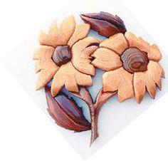 daisy intarsia by Garnet Hall for Canadian Woodworking Magazine   #daisiespattern #canadianwoodworking #freepatternsforwoodworking #scrollsawproject  https://www.canadianwoodworking.com/plans-projects/dandy-daisy