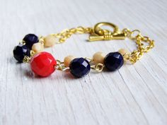 Color block bracelet navy and coral red beaded by NestBirdDesigns