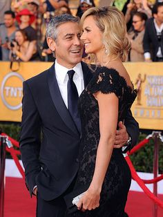 A+ these 2 know how to do it right.  Gorgeous dress, Great Tux.  They looked amazing