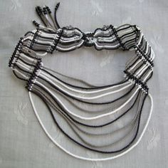 Make a statement with this striking micro macrame choker.  Hand-knotted with love and beaded with lots of tiny seed beads in gray, white, and black - reminiscent of zebra stripes.  Rows of fringe bead