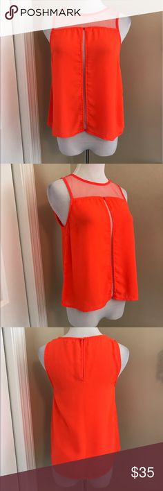 NWT, Gianni Bini, Stunning Bright Orange Panel Top NWT, Gianni Bini, Stunning Bright Orange Mesh Panel Top! Mesh panel neckline with mesh panel down center front. Back keyhole hook closure. Truly stunning! Self: 100% polyester & contrast 100% nylon. Size XS. 🚫No Trades Gianni Bini Tops Blouses