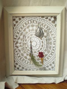 Jewelry holder: old frame, industrial stapler, lace/doily, & fabric stiffener