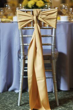 Gold chair ribbon. Simple. Photography by nathanabplanalp.com/weddings,