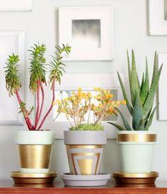 Stunning terra cotta pots with gold leafing. #DIYHomeDecorGold