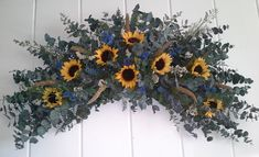 eucalyptus wreaths and swags | ... are gathered on a lush bed of preserved eucalyptus. Swag shown is 36
