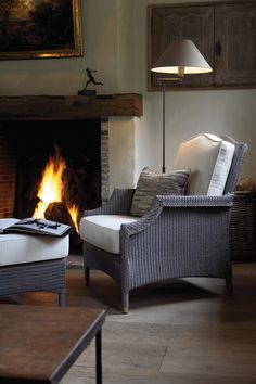 Like the mantel and the gray brick surround.  Also like the way this chair is tucked into the corner.  This is a great solution for that odd corner line in the great room.