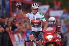 Alberto Contador greets his fans during the final race of his career
