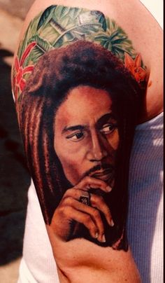 What does bob marley tattoo mean? We have bob marley tattoo ideas, designs, symbolism and we explain the meaning behind the tattoo. Wicked Tattoos, Cool Tattoos, Amazing Tattoos, Tatoos, Bob Marley Colors, Really Bad Tattoos, Celebrity Bobs, Hyper Realistic Tattoo, Best Tattoo Ever