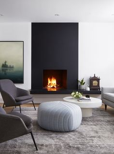 Palmerston is a boutique interior design business specializing in residential and commercial spaces. Home Fireplace, Modern Fireplace, Living Room With Fireplace, Living Room Kitchen, Home Living Room, Living Room Designs, Living Room Decor, Contemporary Fireplace Designs, Black Fireplace