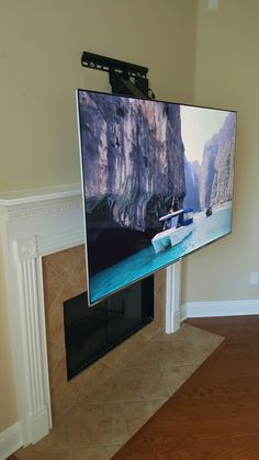 Dynamic Mount For Tv Allows You To Move The Down Over Fireplace More
