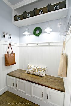 Mudroom makeover!  Make it bright and light with these awesome DIY tips, and craft your own DIY bench.  Check it out at thriftydecorchick.com!