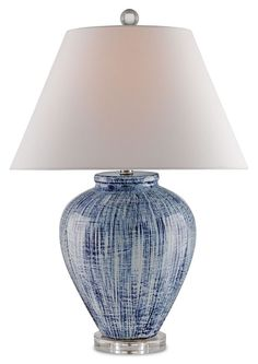 The Currey and Company Ceramic Malaprop Table Lamp features a blue and white finish with a clear acrylic base. The lamp comes with a white linen shade. Shade measures 10'' x 19'' x 11''. The lamp is 2