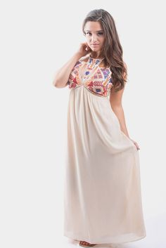 Looking for a dress that's casual, comfy, but also makes a statement? The Ashlee Cream Maxi Dress is your answer! This dress has an intricate, colorful detailed top with vibrant colors that pop. There