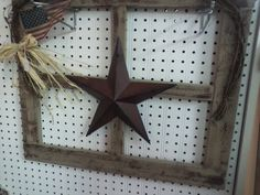Primitive window frame with metal star.. could maybe make one out of tobbacco sticks?