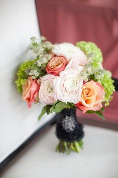 coral-and-pink-and-green-bouquet-black-wrap